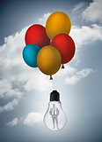 Businessman inside light bulb held by balloons