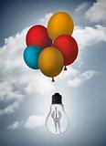 Businessman inside light bulb held by balloons