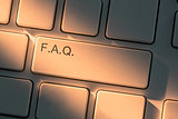 Keyboard with close up on Frequently Asked Question button