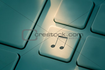 Black music note button on keyboard