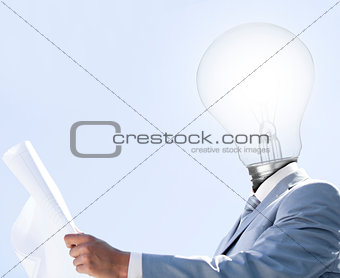 Man with light bulb head reading