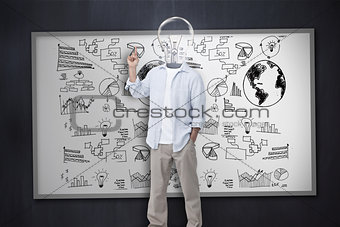 Man with light bulb instead of head in front of white board