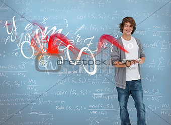 Student posing in front of chalk board