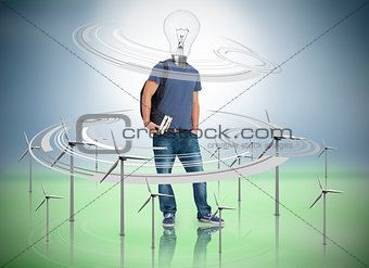 Boy with light bulb for a head surrounded by wind turbines