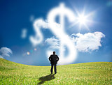 Businessman looking at cloud dollar signs
