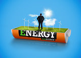 Businessman in wind turbine field in an energy saving battery