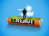 Businessman in a sunny field in an energy saving battery