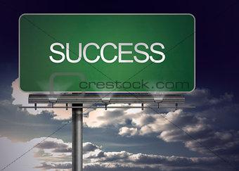 Green billboard with success written on it