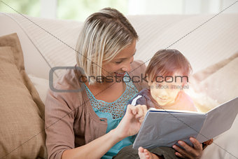 Mother and her son reading a glowing story together