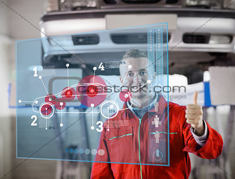 Portrait of smiling mechanic showing thumbs up with futurist interface