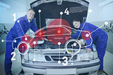 Two happy mechanics consulting futuristic interface with open hood