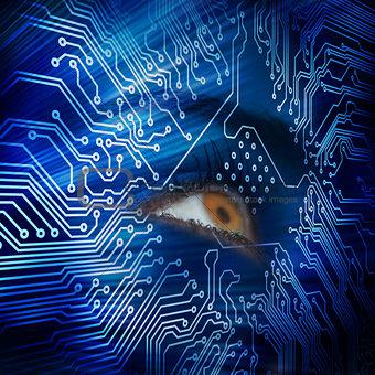 Brown eye looking up in blue circuit board