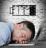 Businessman sleeping on his laptop with low battery symbol