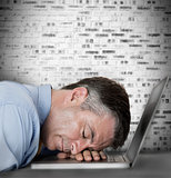 Businessman sleeping on his laptop