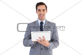 Smiling businessman holding a tablet computer
