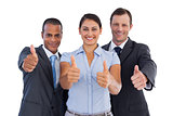 Group of smiling business people showing their thumbs up