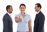 Businesswoman giving her hand in the middle of two businessmen