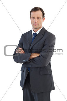 Charismatic businessman standing with arms crossed