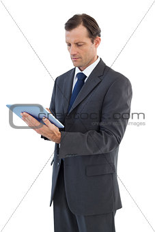Charismatic businessman holding a tablet pc