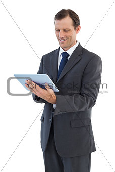 Smiling businessman holding a tablet pc