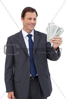 Smiling businessman holding bills