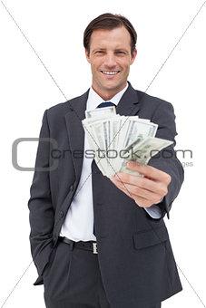 Smiling businessman holding cash