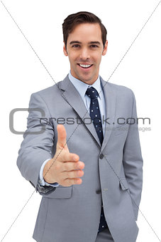 Smiling businessman giving a helping hand
