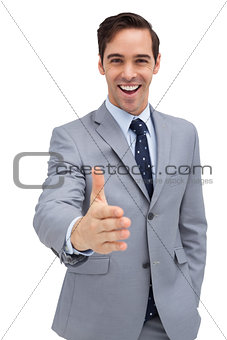 Attractive businessman giving a helping hand
