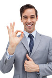 Cheerful businessman showing ok sign