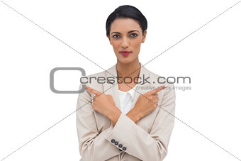 Charismatic businesswoman with her arms crossed and fingers pointing