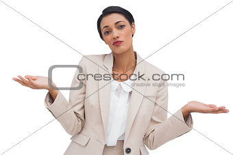 Confused attractive young businesswoman