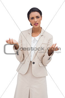 Confused businesswoman standing