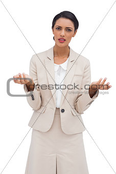 Portrait of a businesswoman confused