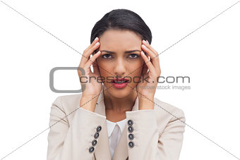 Young attractive businesswoman having a headache