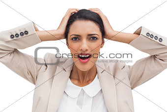 Businesswoman holding her head between hands