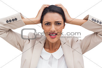 Young businesswoman holding her head between hands