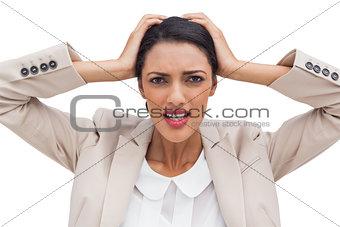 Young businesswoman holding her head between hands