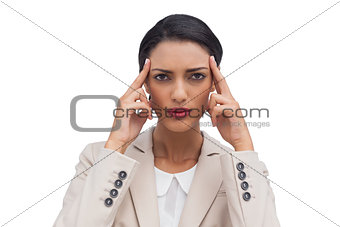 Businesswoman putting her fingers on her temples