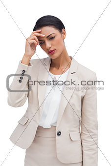Worried businesswoman holding her head