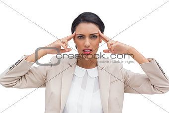 Concentrated businesswoman putting her fingers on her temples
