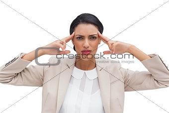 Concentrated young businesswoman putting her fingers on her temples
