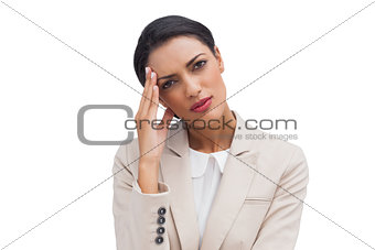 Tired businesswoman holding her head