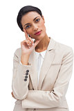 Cheerful pensive businesswoman standing