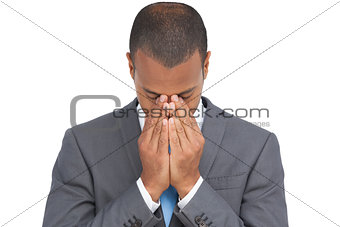 Businessman holding his head between hands