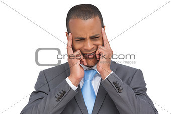 Stressed businessman putting his fingers on his temples