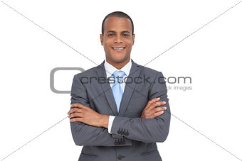 Charismatic young businessman with arms crossed