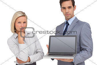 Business people presenting a laptop