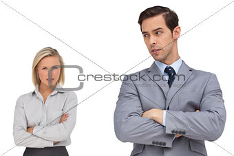Business people standing together showing rivalry