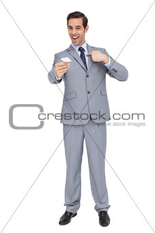 Charismatic businessman showing his business card