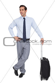 Charismatic businessman standing with his suitcase